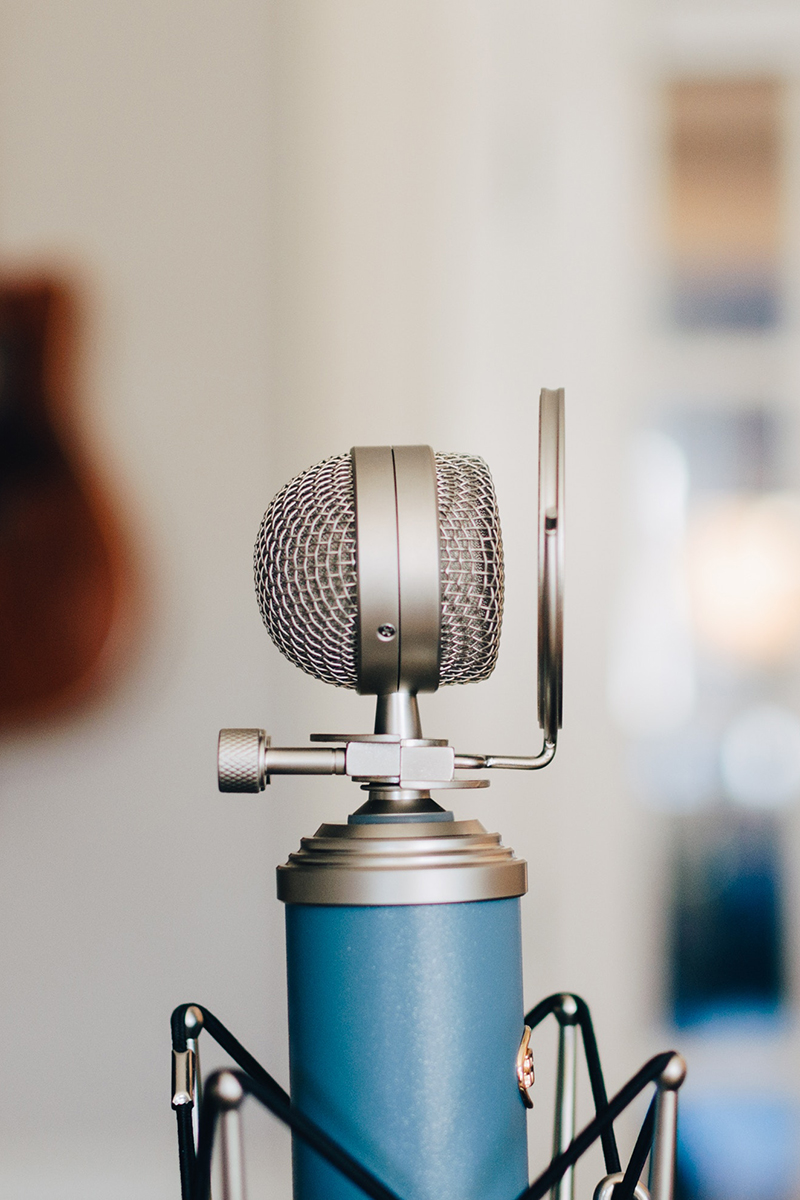 Blue podcast mic to signify adjusting audio in adobe premiere pro